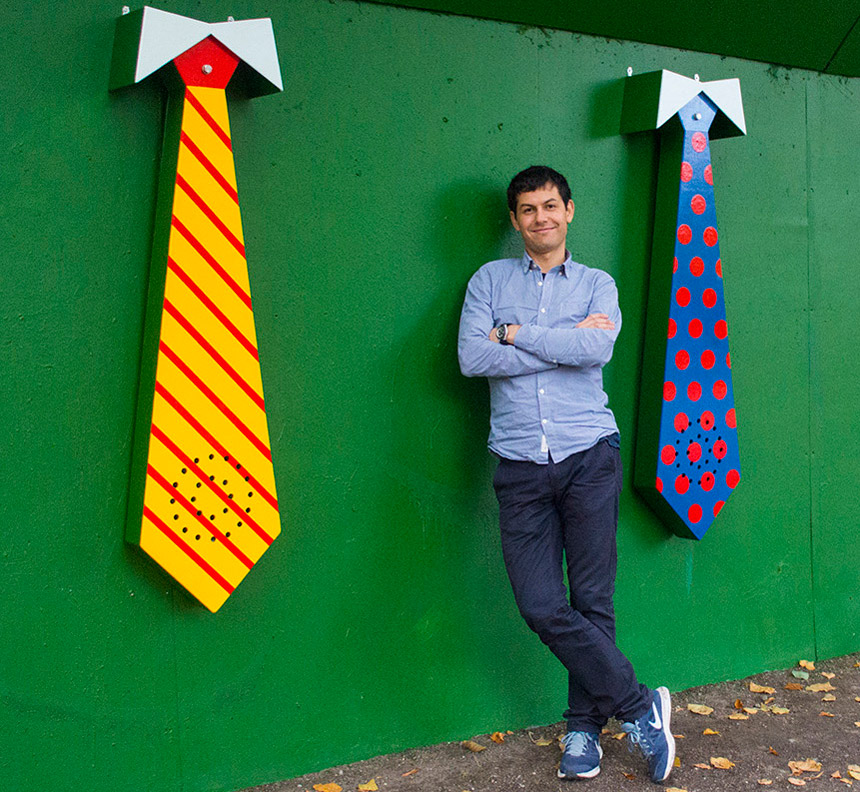 Artist George Koutsouris in front of his ties artworks